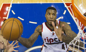 Photo - Portland Trail Blazers' Thomas Robinson goes up to shoot during the first half of an NBA basketball game against the Philadelphia 76ers, Saturday, Dec. 14, 2013, in Philadelphia. (AP Photo/Chris Szagola)