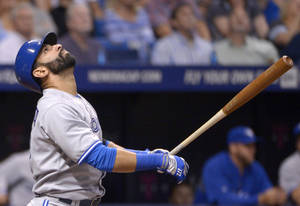 Photo - Toronto Blue Jays' Jose Bautista watches the flight of the ball after hitting a pop up for an out during the fifth inning of a baseball game against the Tampa Bay Rays in St. Petersburg, Fla., Thursday, April 3, 2014. (AP Photo/Phelan M. Ebenhack)