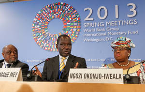 Photo - Ngozi Okonjo-Iweala, right,  of Nigeria listens with Ali Soilihi, left, Vice President,  Ministry of Finance and Economy, Budget, External Trade and Privatization, Union of Comoros as Alamine Ousmane Mey, center, Minister of Finance of Cameroon speaks  during the new briefing by African Finance Ministers at the World Bank IMF Spring Meetings in Washington, April 20, 2013.   (AP Photo/Molly Riley)
