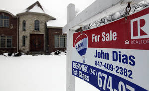 "Photo - In this Wednesday, Feb. 27, 2013, photo, a ""for sale"" sign is seen outside a home in Glenview, Ill., Average U.S. rates on fixed mortgages moved closer to historic lows this week, a trend that has helped drive a rebound in home sales.  (AP Photo/Nam Y. Huh)"
