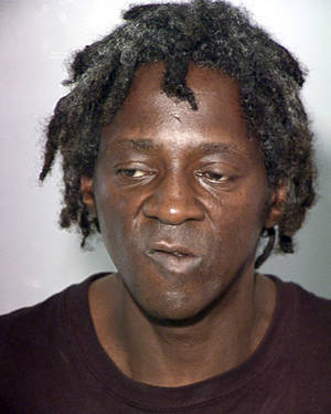 Photo -   FILE - This Oct. 17, 2012, file photo, provided by the Las Vegas Police Department shows rapper Flavor Flav, whose name is William Jonathan Drayton Jr., in a police booking photo in Las Vegas. A Las Vegas judge will be asked to delay an evidence hearing for the entertainer on felony charges stemming from an argument last month with his longtime girlfriend. Both sides say the 53-year-old former rap and reality TV star won't appear in person on Tuesday, Nov. 20, 2012, during a date-setting hearing before Justice of the Peace Melissa Saragosa. (AP Photo/Las Vegas Police Department, File)