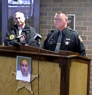 Photo - Sheriff Travis Hutchinson, right, speaks with reporters as Jim Ciotti of the Ohio Bureau of Criminal Investigation looks on, during a news conference at the Wayne County Justice Center in Wooster, Ohio, Sunday, Dec. 15, 2013.  Jerrod Metsker, 24, was arrested at his home on a murder charge about 12 hours after deputies found the body of Reann Murphy near her home at a mobile park in Smithville, about 30 miles southwest of Akron, Hutchinson said. Reann was last seen Saturday night playing outdoors at the park. Officers, firefighters and neighbors joined in the search for Reann, going door-to-door and combing area properties. Hutchinson wouldn't say how Reann was killed or offer a motive. He described Metsker as a family friend and neighbor.  (AP Photo/Akron Beacon Journal,  Mary Beth Breckenridge)  MANDATORY CREDIT