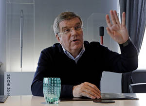 Photo - International Olympic Committee President Thomas Bach answers a question in his office during an Associated Press interview at the 2014 Winter Olympics, Saturday, Feb. 22, 2014, in Sochi, Russia. (AP Photo/Morry Gash)