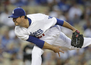 Photo - Los Angeles Dodgers starting pitcher Josh Beckett throws against the Miami Marlins during the third inning of a baseball game on Tuesday, May 13, 2014, in Los Angeles. (AP Photo)