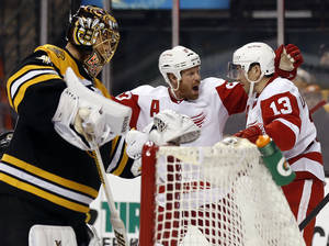 Photo - Detroit Red Wings' Pavel Datsyuk (13) is congratulated by teammate Johan Franzen after scoring against Boston Bruins goalie Tuukka Rask, left, during the third period of Detroit's 1-0 win in Game 1 of a first-round NHL playoff hockey series, in Boston on Friday, April 18, 2014. (AP Photo/Winslow Townson)