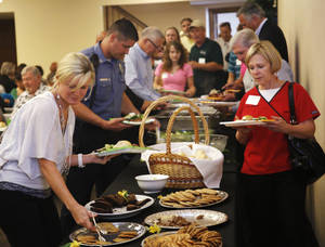 Photo - About 300 Edmond city employees and members of city boards and commissions were honored at a dinner put on by the city staff. PHOTO BY DOUG HOKE, THE OKLAHOMAN <strong>DOUG HOKE</strong>
