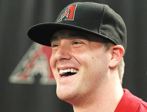 Photo - Arizona Diamondbacks' first-round draft pick Archie Bradley, the seventh overall selection in the recent First-Year Player Draft out of Broken Arrow High School in Broken Arrow, Okla., smiles during a press conference at Chase Filed in Phoenix, AZ.  (Photo by Rob Schumacher/The Arizona Republic)