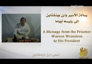 Photo -   In an image provided by IntelCenter a still from the video released Sunday by al-Qaida of American hostage Warren Weinstein Weinstein said said he will be killed unless President Barack Obama agrees to the militant group's demands. (AP Photo/IntelCenter) Mandatory Credit No Sales