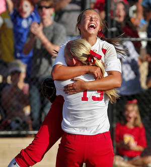 Photo - Dale pitcher Erin Harris screams as she jumps into the arms of Jaelin Flewallen after the final out that secured their team's championship victory against Savanna in Shawnee on Saturday.  Photo by Jim Beckel, The Oklahoman