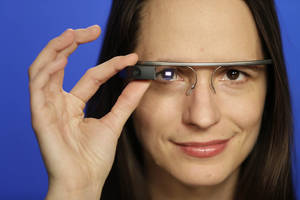 Photo - Associated Press Technology Writer Barbara Ortutay wears Google Glass in New York, Friday, Feb. 21, 2014.  (AP Photo/Seth Wenig)