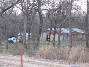 Photo - The home at 11805 Air Depot Blvd. where police say a man was found shot to death Wednesday afternoon.  Photo by Matt Dinger,  The Oklahoman