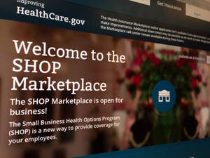 Photo - FILE - This Nov. 27, 2013, file photo shows part of the HealthCare.gov website page featuring information about the SHOP Marketplace is photographed in Washington, on Nov. 27, 2013. Trying to limit election-year damage on health care, the Obama administration Monday, Feb. 10, 2014, granted business groups another delay in a much-criticized requirement that larger firms cover their workers or face fines. (AP Photo/Jon Elswick, File)