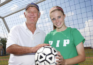 Photo - GIRLS HIGH SCHOOL SOCCER: Noble girls soccer coach Larry Worden and senior Shelbie West, Monday, April 30, 2012. Photo By David McDaniel/The Oklahoman