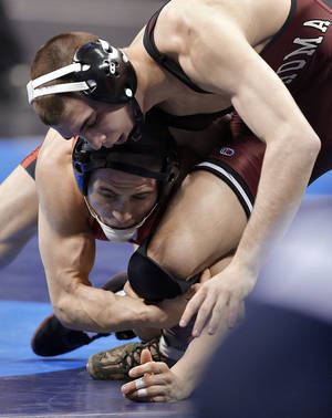 Photo - Oklahoma's Cody Brewer takes on Wisconsin's Tyler Graff in the 133 pound match during the 2014 NCAA Div. 1 Wrestling Championships at Chesapeake Energy Arena in Oklahoma City, Okla. on Friday, March 21, 2014. Photo by Chris Landsberger, The Oklahoman