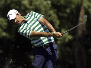 Photo - Matteo Manassero, of Italy, hits from the seventh fairway during the second round of the Valspar Championship golf tournament at Innisbrook Friday, March 14, 2014, in Palm Harbor, Fla. (AP Photo/Chris O'Meara)