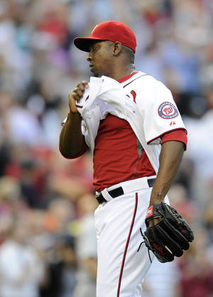 Photo - Washington Nationals relief pitcher Rafael Soriano (29) untucks his jersey as the Nationals defeat the Detroit Tigers 5-4 in a baseball game, Thursday, May 9, 2013, in Washington. (AP Photo/Nick Wass)