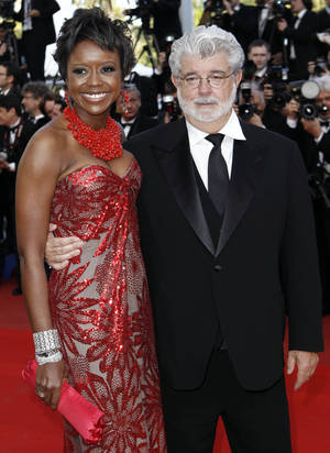 "Photo - In this May 14, 2010 photo, Filmmaker George Lucas, right, and Mellody Hobson arrive for the screening of ""Wall Street Money Never Sleeps"", at the 63rd international film festival, in Cannes, southern France. A spokeswoman for Lucasfilm said on Thursday, Jan. 3, 2013, the 68-year-old director is engaged to 43-year-old investment firm president Mellody Hobson. (AP Photo/Matt Sayles, File)"
