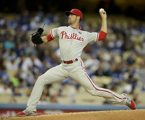 Photo - Philadelphia Phillies starting pitcher Cole Hamels throws against the Los Angeles Dodgers during the first inning of a baseball game on Wednesday, April 23, 2014, in Los Angeles. (AP Photo/Jae C. Hong)