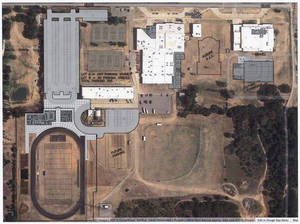 Photo - This is an aerial view of what the Harrah High School campus area would look like if the Harrah school board schedules a vote and voters approve a $36.47 million bond issue. Architect's rendering provided <strong>Prepress</strong>