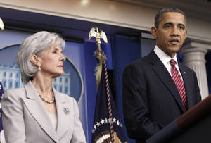Photo - President Barack Obama, accompanied by U.S. Health and Human Services Secretary Kathleen Sebelius, discusses the contraception mandate Feb. 10 in the Brady Press Briefing Room of the White House. AP photo <strong>Pablo Martinez Monsivais</strong>