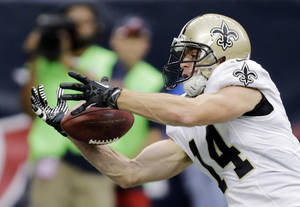 Photo - New Orleans Saints wide receiver Andy Tanner (14) makes a 15-yard touchdown reception against the Houston Texans during the second half of a preseason NFL football game on Sunday, Aug. 25, 2013, in Houston. (AP Photo/Eric Gay)