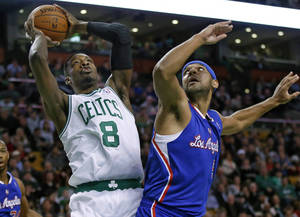 Photo - Boston Celtics guard Jeff Green (8) shoots against Los Angeles Clippers forward Jared Dudley in the first quarter of an NBA basketball game in Boston, Wednesday, Dec. 11, 2013. (AP Photo/Elise Amendola)