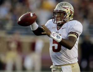 Photo - Florida State quarterback Jameis Winston (5) throws a pass during the second half of an NCAA college football game against Boston College in Boston, Mass., Saturday, Sept. 28, 2013. Florida State defeated Boston College 48-34. (AP Photo/Stephan Savoia)