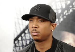 "photo - FILE - In this March 2, 2010 file photo, rapper Ja Rule attends the premiere of ""Brooklyn's Finest"" in New York. Platinum-selling rapper Ja Rule was set to leave an upstate New York prison on Thursday, Feb. 21, 2013 after serving most of his two-year sentence for illegal gun possession but head straight into federal custody in a tax case. (AP Photo/Peter Kramer, File)"
