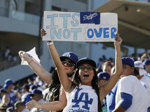 Photo - Los Angeles Dodgers fans cheer after Game 5 of the National League baseball championship series against the St. Louis Cardinals Wednesday, Oct. 16, 2013, in Los Angeles. The Dodgers won 6-4 and trail in the series 3-2. (AP Photo/Chris Carlson)