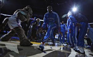 Photo - Oklahoma City's Kevin Durant (35) goes through team introductions during the first round NBA playoff game between the Oklahoma City Thunder and the Denver Nuggets on Sunday, April 17, 2011, in Oklahoma City, Okla. Photo by Chris Landsberger, The Oklahoman