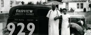 Photo -  A young Nick stands by his father, Nicholas Harroz Sr., who in 1929 opened Fairview Grocery at SW 29 and Agnew.      <strong> -   </strong>