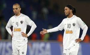 Photo - Atletico Mineiro players Ronaldinho, right, and Diego Tardelli react after missing a goal during the semi final soccer match between Raja Casablanca and Atletico Mineiro at the Club World Cup soccer tournament in Marrakech, Morocco, Wednesday, Dec. 18, 2013. (AP Photo/Christophe Ena)