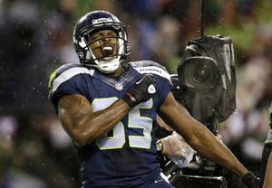 Photo - Seattle Seahawks' Anthony McCoy reacts after scoring against the San Francisco 49ers late in the first half of an NFL football game, Sunday, Dec. 23, 2012, in Seattle. (AP Photo/Elaine Thompson)