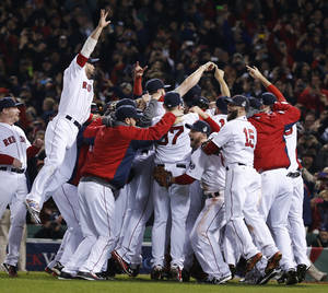Photo - Boston Red Sox players celebrate after defeating the St. Louis Cardinals in Game 6 of baseball's World Series Wednesday, Oct. 30, 2013, in Boston. The Red Sox won 6-1 to win the series. (AP Photo/Elise Amendola)