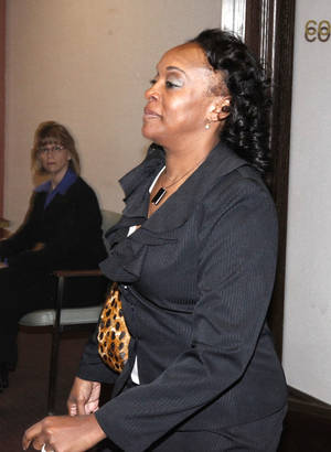 photo - Former judge Tammy Bass-LeSure walks through the Oklahoma County Courthouse in Oklahoma City, OK, during the sentencing phase of her trial, Friday, March 2, 2012. By Paul Hellstern, The Oklahoman