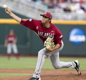 Photo -   Arkansas starting pitcher DJ Baxendale throws against South Carolina in the first inning of an NCAA College World Series baseball elimination game in Omaha, Neb., Friday, June 22, 2012. The winner advances to play Arizona in the championship series. (AP Photo/Nati Harnik)