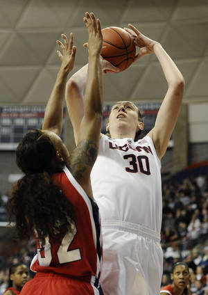 Photo - Connecticut's Breanna Stewart shoots over Houston's Te'onna Campbell, left, during the first half of an NCAA college basketball game, Tuesday, Jan. 7, 2014, in Storrs, Conn. (AP Photo/Jessica Hill)