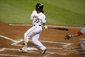 Photo - Pittsburgh Pirates' Andrew McCutchen drives in a run with a single off Washington Nationals starting pitcher Blake Treinen  during the fifth inning of a baseball game in Pittsburgh Thursday, May 22, 2014. (AP Photo/Gene J. Puskar)