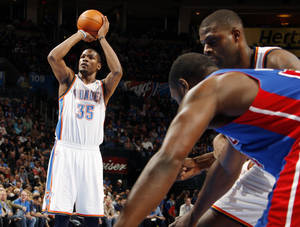 photo - Oklahoma City's Kevin Durant (35) takes a foul shot during the NBA basketball game between the Detroit Pistons and Oklahoma City Thunder at the Chesapeake Energy Arena in Oklahoma City, Monday, Jan. 23, 2012. Photo by Nate Billings, The Oklahoman