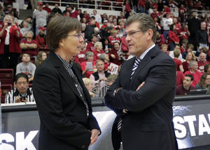 Photo - FILE - In this Dec. 29, 2012, file photo, Connecticut head coach Geno Auriemma, right, talks with Stanford head coach Tara Van Derveer before their NCAA college basketball game in Stanford, Calif. (AP Photo/Tony Avelar, File)