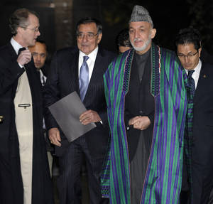 Photo - U.S. Defense Secretary Leon Panetta and Afghanistan President Hamid Karzai arrive for their joint news conference at the Presidential Palace in Kabul, Afghanistan, Thursday, Dec. 13, 2012. (AP Photo/Susan Walsh, Pool)