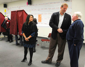 photo -   U.S. Congressman Jon Runyan shakes hands with a voter as his wife Loretta left, at the Mount Laurel Fire Station on Tuesday, Nov. 6, 2012. Runyan voted at the fire station. Runyan is running against challenger Shelley Adler. (AP Photo/Burlington County Times, Dennis McDonald ) PHILLY METRO OUT; PHILADELPHIA INQUIRER OUT; AND CAMDEN COURIER POST OUT.