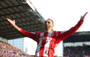 Photo - Stoke City's Peter Odemwingie celebrates scoring his side's third goal during their English Premier League soccer match against West Ham at the Britannia Stadium, Stoke, England, Saturday, March 15, 2014. (AP Photo/Dave Thompson, PA Wire)   UNITED KINGDOM OUT   -   NO SALES   -  NO ARCHIVES