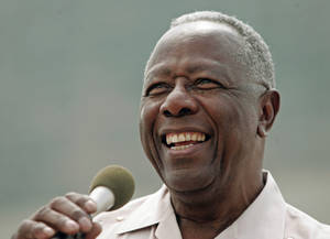 Photo - FILE - In this June 7, 2007 file photo, baseball Hall of Famer Hank Aaron smiles as he speaks at a ceremony where a commemorative plaque was unveiled at Miller Park in Milwaukee. Aaron's 80th birthday is celebrated in the nation's capital at a reception hosted by baseball Commissioner Bud Selig, Friday, Feb. 7, 2014.  (AP Photo/Morry Gash, File)