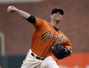Photo - San Francisco Giants starting pitcher Tim Hudson throws to the Cleveland Indians during the first inning of a baseball game Friday, April 25, 2014, in San Francisco. (AP Photo/Marcio Jose Sanchez)