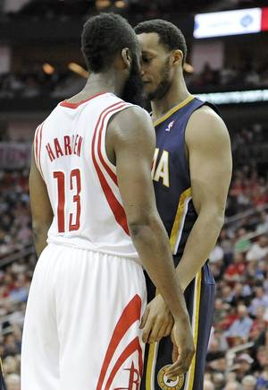Photo - Houston Rockets' James Harden (13) and Indiana Pacers' Evan Turner get in each others' faces in the second half of an NBA basketball game on Friday, March 7, 2014, in Houston. Both players received double technical fouls for the confrontation that included shoving. (AP Photo/Pat Sullivan)