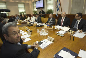 Photo -   Israel's Minister Ehud Barak, left, sits across from the Prime Minister Benjamin Netanyahu during the weekly cabinet meeting in Jerusalem Sunday, April 29, 2012. (AP Photo/Ronen Zvulun, Pool)