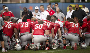 Photo - Ohio State coach Urban Meyer talks to his players during the practice session for the Orange Bowl, Monday, Dec. 30, 2013 in Davie, Fla. The team will play Clemson in the Orange Bowl Friday. (AP Photo/J Pat Carter)
