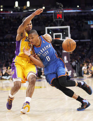Photo - The Thunder's Russell Westbrook drives past Los Angeles' Ramon Sessions during Game 4.  Photo by Nate Billings, The Oklahoman