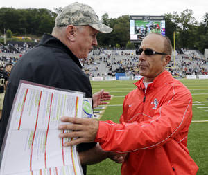 Photo -   Army head coach Rich Ellerson, left, and Stony Brook head coach Chuck Priore shake hands after Stony Brook's 23-3 win in an NCAA college football game Saturday, Sept. 29, 2012, in West Point, N.Y. (AP Photo/Mike Groll)